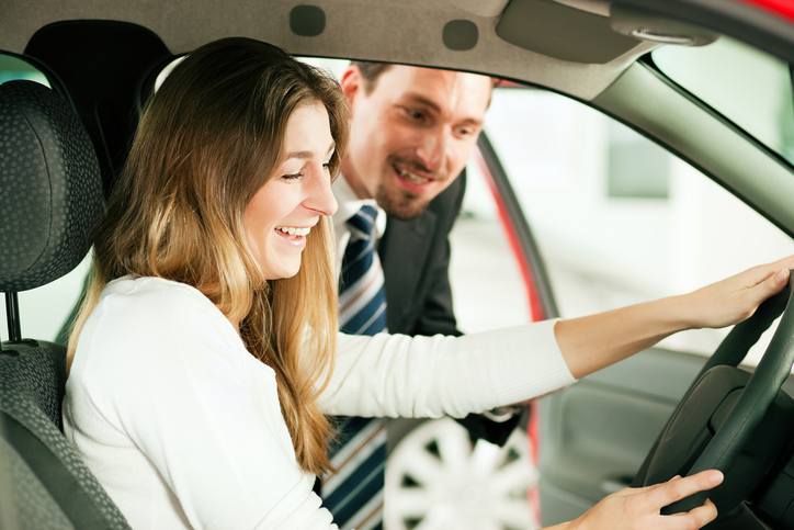 Woman taking car on test drive